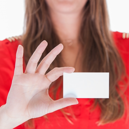 Woman in red showing a blank business card photo