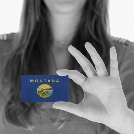 Woman showing a business card, black and white, Montana photo