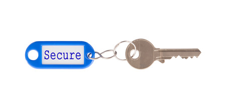Key with blank label isolated on white background, secure photo