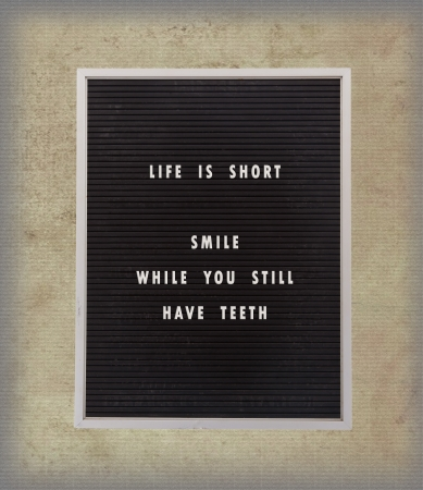 Funny, inspirational quotation about life on a very old menu board, vintage background photo