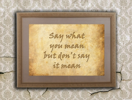 positiveness: Old wooden frame with written text on an old wall - Say what you mean