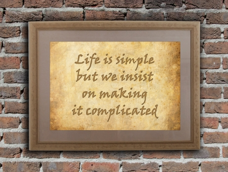 simple life: Old wooden frame with written text on an old wall - Life is simple