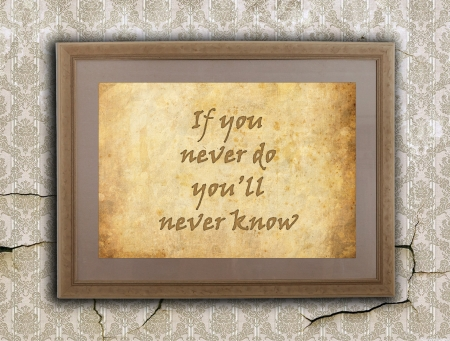Old wooden frame with written text on an old wall - If you never do you'll never know photo