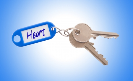 Key with blank label isolated on white background, heart photo