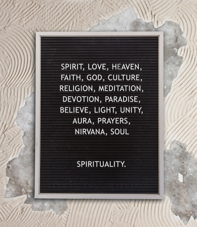 Spirituality concept in plastic letters on very old menu board, vintage look Stock Photo - 23562277