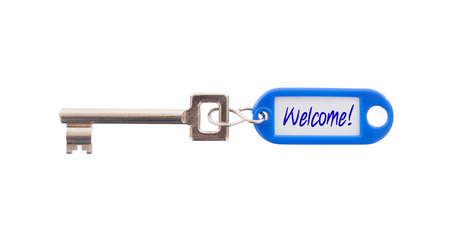 Key with blank label isolated on white background, welcome photo
