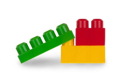 plastic bricks: Colorful plastic bricks isolated on white