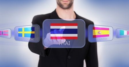 thai language: Hand pushing on a touch screen interface, choosing language or country