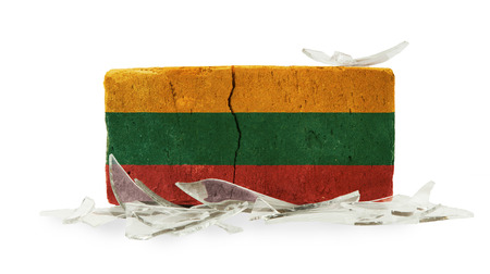 Brick with broken glass, violence concept, flag of Lithuania photo