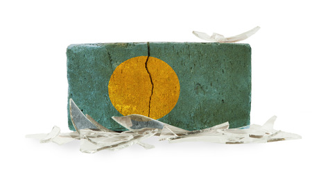 Brick with broken glass, violence concept, flag of Palau photo
