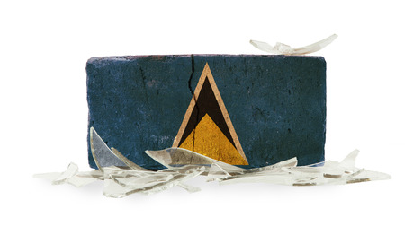 saint lucia: Brick with broken glass, violence concept, flag of Saint Lucia Stock Photo