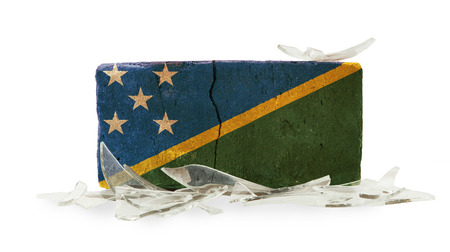 Brick with broken glass, violence concept, flag of The Solomon Islands photo