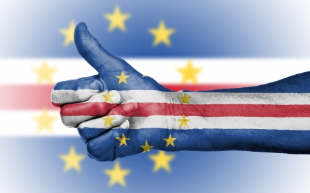 Old woman giving the thumbs up sign, isolated, flag of Cape Verde Stock Photo