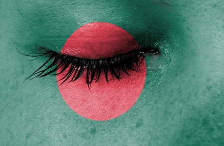 Crying woman, pain and grief concept, flag of Bangladesh photo