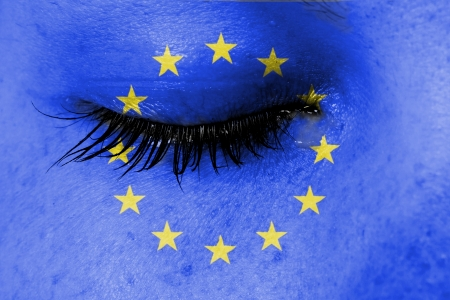 Crying woman, pain and grief concept, flag of European Union photo