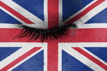 Crying woman, pain and grief concept, flag of the United Kingdom photo