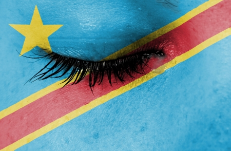 Crying woman, pain and grief concept, flag of Congo photo