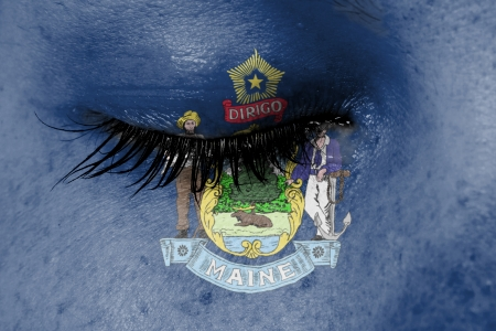 Crying woman, pain and grief concept, flag of Maine photo