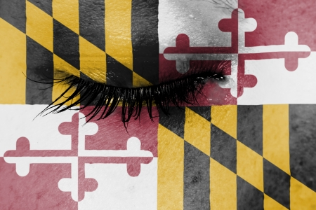 Crying woman, pain and grief concept, flag of Maryland photo