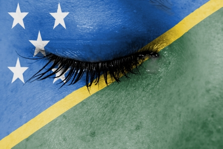 Crying woman, pain and grief concept, flag of The Solomon Islands photo