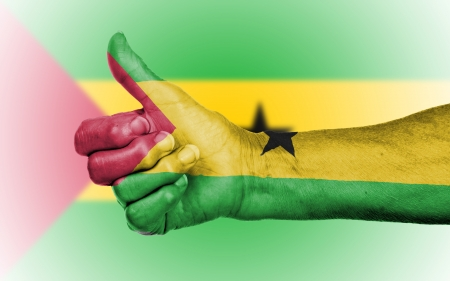 Old woman giving the thumbs up sign, isolated, flag of Sao Tome and Principe photo