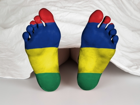 resurrect: Feet with flag, sleeping or death concept, flag of Mauritius