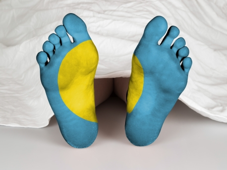 resurrect: Feet with flag, sleeping or death concept, flag of Palau