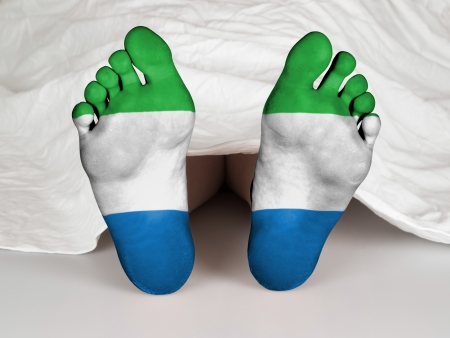 resurrect: Feet with flag, sleeping or death concept, flag of Siera Leone