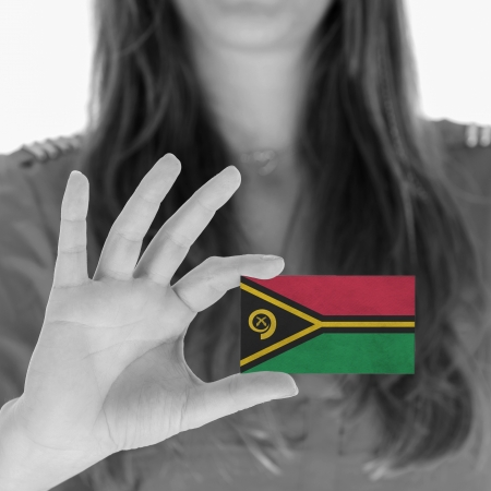 Woman showing a business card, flag of Vanuatu photo