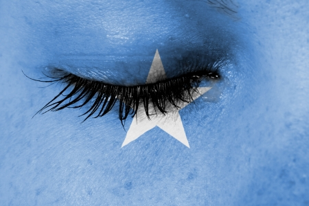 Crying woman, pain and grief concept, flag of Somalia photo