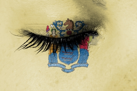 Crying woman, pain and grief concept, flag of New Jersey photo