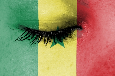 Crying woman, pain and grief concept, flag of Senegal photo