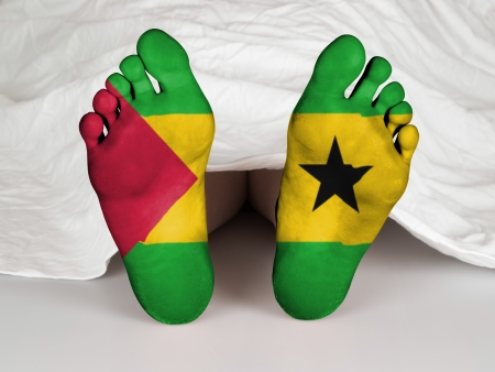 resurrect: Feet with flag, sleeping or death concept, flag of Sao Tome and Principe