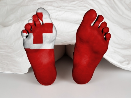 resurrect: Feet with flag, sleeping or death concept, flag of Tonga