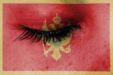 Crying woman, pain and grief concept, flag of Montenegro photo
