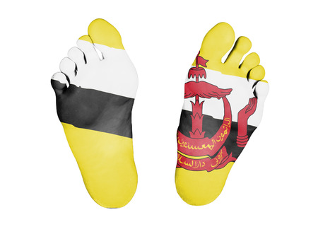 resurrect: Feet with flag, sleeping or death concept, flag of Brunei Stock Photo