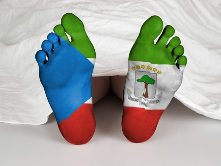 resurrect: Feet with flag, sleeping or death concept, flag of Equatorial Guinea Stock Photo
