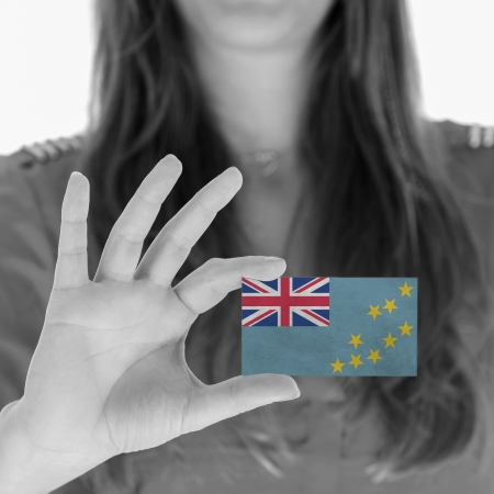 Woman showing a business card, flag of Tuvalu photo