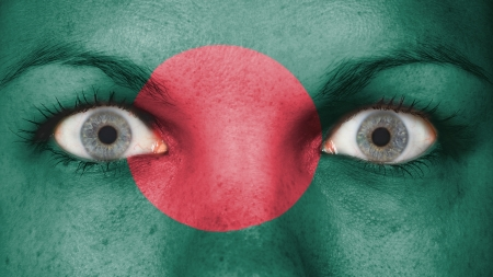 rooting: Close up of eyes. Painted face with flag of Bangladesh
