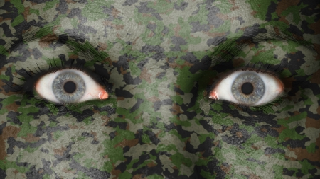 Close up of eyes. Painted face with camouflage photo