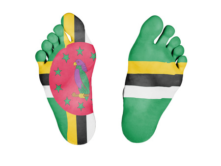 resurrect: Feet with flag, sleeping or death concept, flag of Dominica Stock Photo