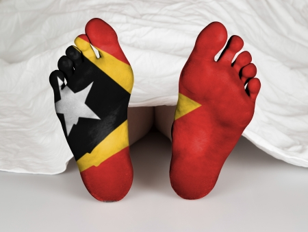 resurrect: Feet with flag, sleeping or death concept, flag of East Timor Stock Photo