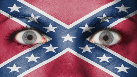 confederation: Close up of eyes. Painted face confederate flag