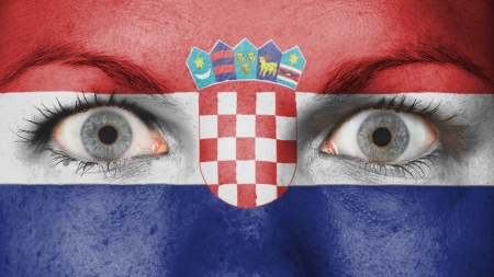 rooting: Close up of eyes. Painted face with flag of Croatia