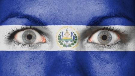 el salvador flag: Close up of eyes. Painted face with flag of El Salvador