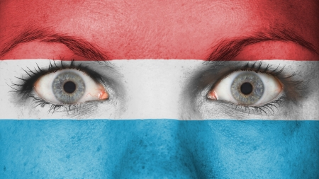 rooting: Close up of eyes. Painted face with flag of Luxembourg
