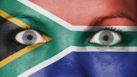 Close up of eyes. Painted face with flag of South Africa photo