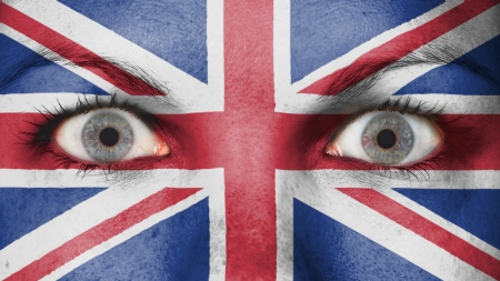 Close up of eyes. Painted face with flag of United Kingdom photo