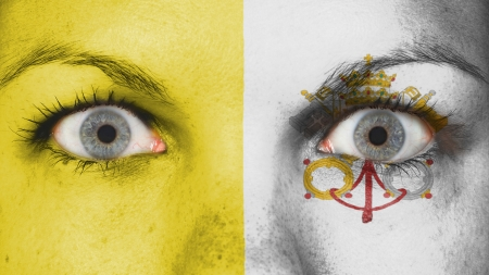 Close up of eyes. Painted face with flag of Vatican City photo