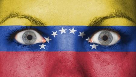 Close up of eyes. Painted face with flag of Venezuela photo